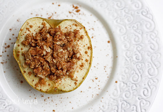 Baked apples topped with oats, cinnamon and brown sugar. Like little individual apple crisps without all the added fuss of cutting and peeling the apples. A simple, low fat, healthy dessert for a cool autumn evening, serve this a la mode for an extra special treat!