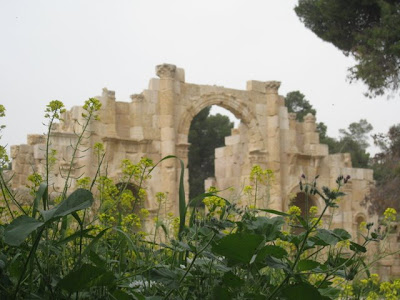 Arch and wildflowers in Jerash Jordan