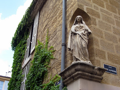 Building with a statue of the Virgin Mary in Aix en Provence