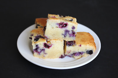 photo of slices of Blueberry Mochi Cake staked on a plate