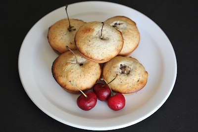 overhead photo of Cherry Almond Cakes stacked on a plate
