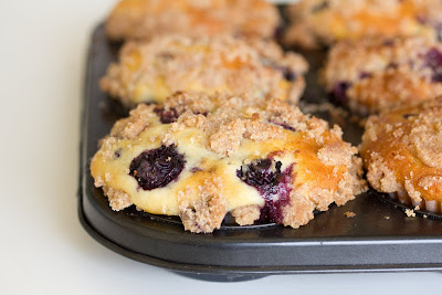 close-up photo of a blueberry muffin in a muffin pan