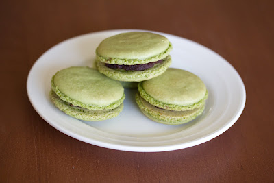 photo of three matcha macarons