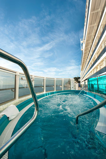 Carnival-Dream-Lanai-whirlpool - Enjoy the view while unwinding in a whirlpool on Carnival Dream's Lanai promenade.