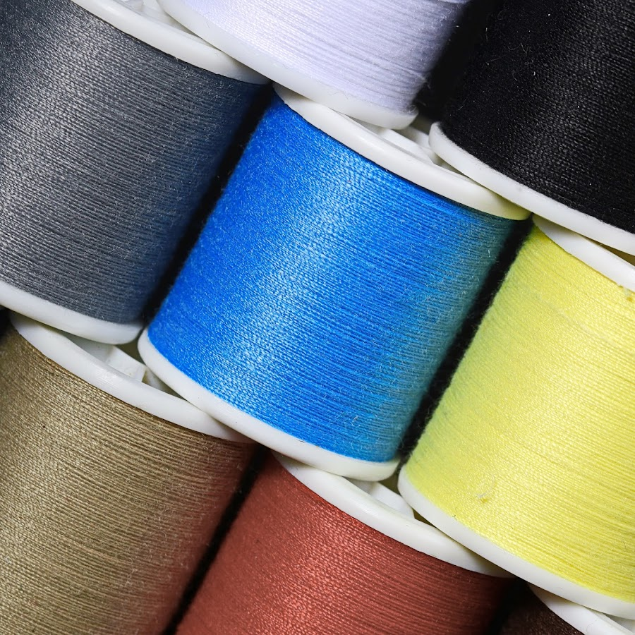 sewing thread bobbins by Axel K. Böttcher - Artistic Objects Business Objects