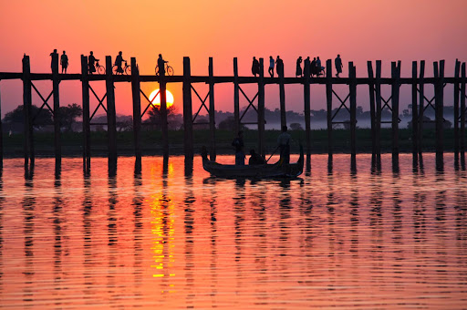 U-Bein-Bridge-in-Amarapura-Myanmar - U Bein Bridge spans Taungthaman Lake near Amarapura in Myanmar. The 4,000-foot-long bridge was built around 1850 and is believed to be the oldest and longest teakwood bridge in the world. See it on a luxury river cruise aboard the AmaPura.