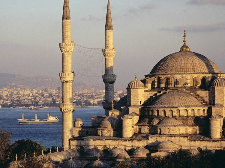 The magnificient 17th-century Sultan Ahmed Mosque, or Blue Mosque, in Istanbul, Turkey, is distinguished by a casdade of domes and six slender minarets.