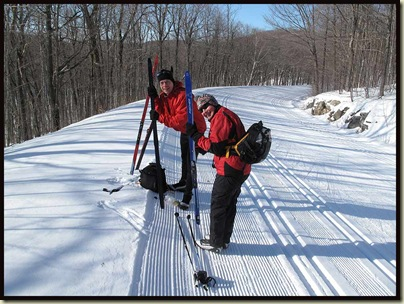Re-waxing skis on the trail