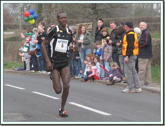 Jean Ndayisenga at the 13 mile mark on his way to winning the Wilmslow Half Marathon - 2011, in 1.04.24
