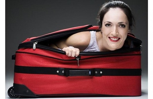 woman-in-suitcase-588x379