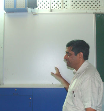Bharat Gajipara explaining the facilities being provided at school