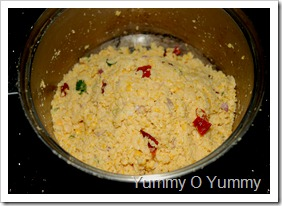 Crushed vada parippu mixture with the other ingredients