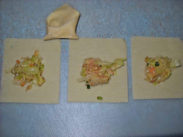 won tons with scoop of filling in the them ready to be folded