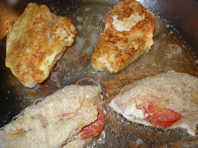 frying the chicken in pan