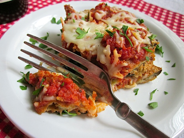 Eggplant Parmesan on white plate with fork