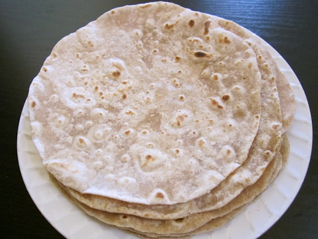 stack of cooked flour tortillas on white plate
