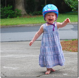helmet..by herself.  Complete with attitude