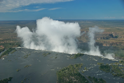 mist victoria falls from helicopter zambia side