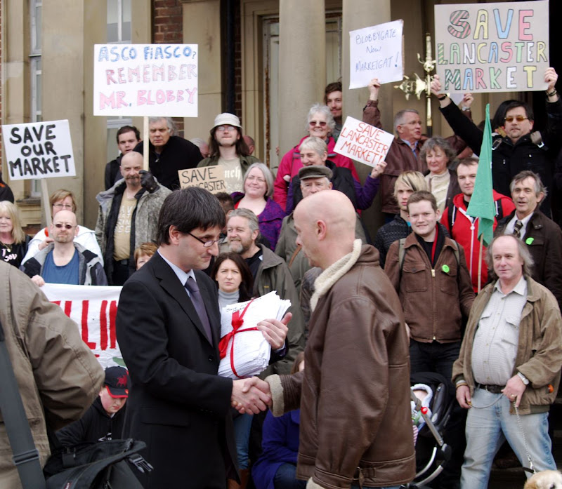Peter Corker hands Stauart Langhorn the 13,000-signature strong petition protesting the proposed closure of Lancaster Market