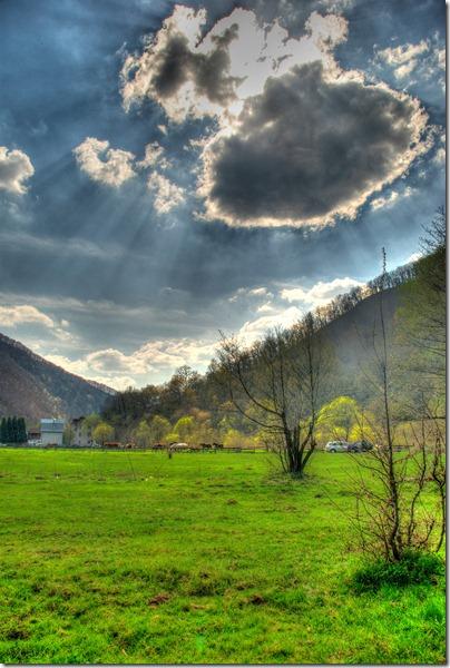nostalgia-sun-behind-the-clouds