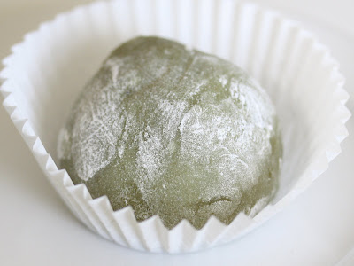 close-up photo of a one green tea mochi