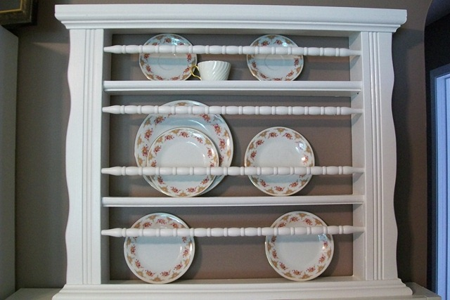 parts of a crib re-purposed into a plate rack