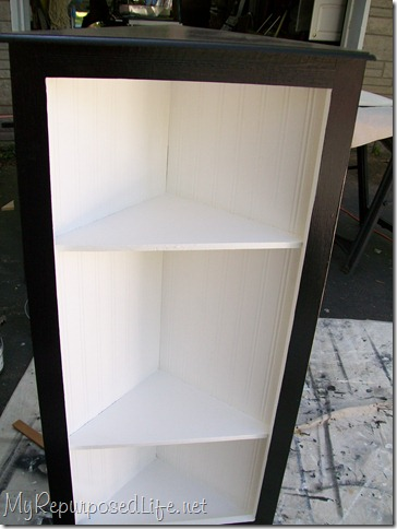 black and white corner cabinet with bead board wallpaper