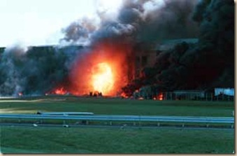 11 September 2001 - Arlington, Virginia - A ball of flame erupts as a commercial airliner crashes inton the Pentagon September 11, 2001. PHOTO CREDIT: DARYL DONLEY / SIPA PRESS