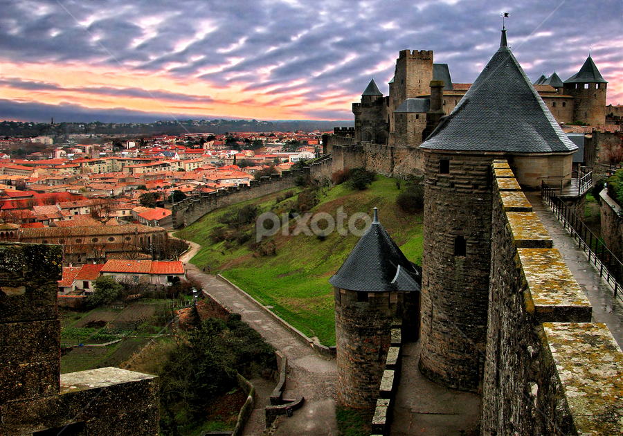 Carcassone fortress after rain by Anton Donev - Buildings & Architecture Public & Historical ( carcassonne, old, famous place, europe, roussillon, dramatic sky, architecture, travel, languedoc-rousillon, king, french riviera, aude, city, knight, traditional culture, gothic style, ancient, sky, no people, after rain, france, travel destinations, protection, clouds, hdr, scenics, art, tourism, fort, landscaped, dusk, mediterranean countries, history, fence, indigenous culture, tower, sunset, castle, town, palace, built structure, medieval, antique, wall )
