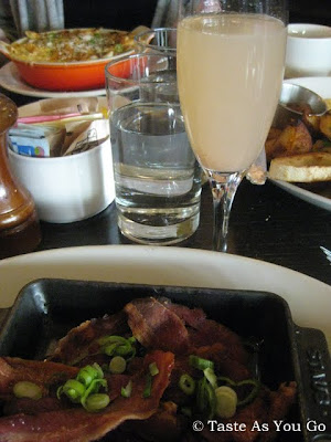 Side of House Cured Bacon and a Bellini at Almond Restaurant in New York, NY - Photo by Taste As You Go
