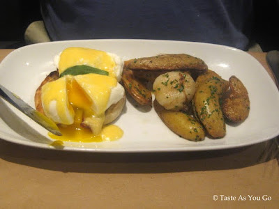 Eggs Benedict with Roasted Fingerling Potatoes and Cippolini Onions at Craftbar in New York, NY - Photo by Taste As You Go