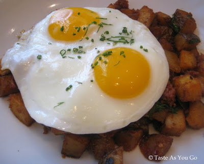 Spicy Chorizo Fresco Hash with Yukon Gold Potatoes and Sunnyside Eggs at Punch Restaurant in New York, NY - Photo by Taste As You Go