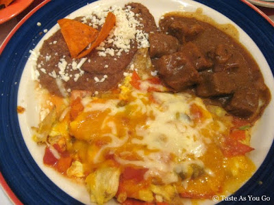 Chilaquiles Famosos with Carne de Res at Mi Tierra Cafe & Bakery in San Antonio, TX - Photo by Taste As You Go