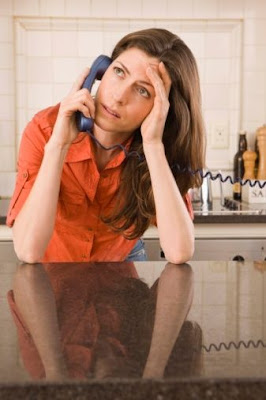 A woman worried and stressing out on a phone.