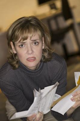 A woman worried about bills, need money loans -- fast!