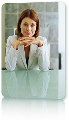 A woman with red hair in a white suit jacket. Does she need debt relief?