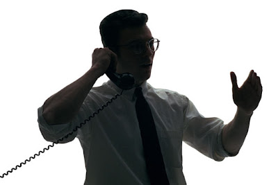 A man dealing with bill charge errors over the phone.