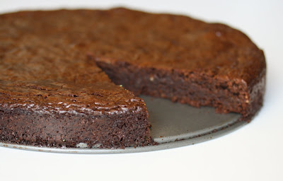 close-up photo of a Flourless Chocolate Hazelnut Torte with a slice removed