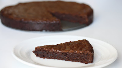 photo of a slice of Flourless Chocolate Hazelnut Torte on a plate