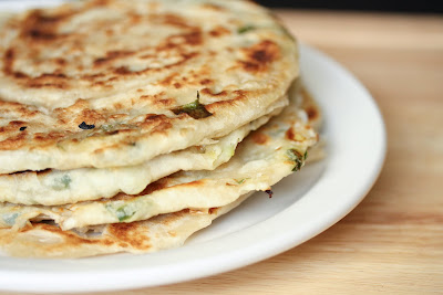 close-up photo of Green Onion Pancakes stacked on a plate