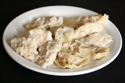 photo of dumplings on a plate