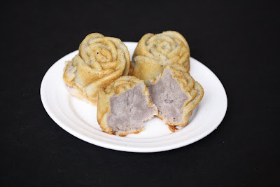 photo of a plate of mochi roses with one split in half