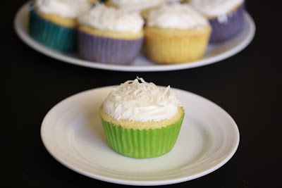 photo of one coconut cupcake on a plate
