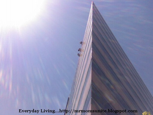 photo of window washers on the roof of a high-rise
