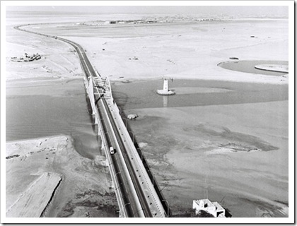 An aerial shot of the empty land of Abu Dhabi, and the road (or  bridge) that was a beginning to Abu Dhabi's future.   Courtesy Al Ittihad