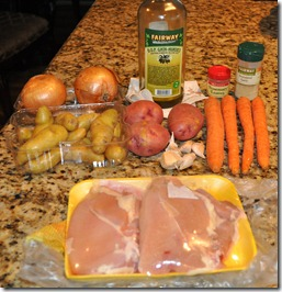 Roasted Chicken With Potatoes Carrots Onions And Garlic