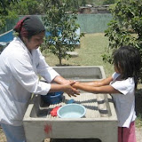 Amanda Luz washing hands before lunch with the swimming pool in the background