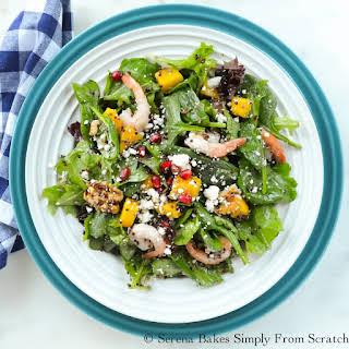 Quinoa Shrimp Mango Pomegranate Spinach Salad with White Balsamic Vinaigrette.