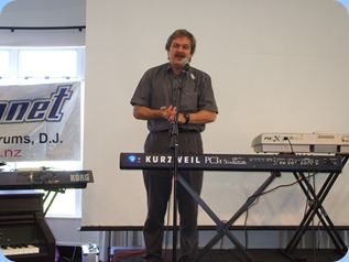 The owner of the Music Planet Group of music stores, Roger Smith, welcoming the audience to the Musical Extravaganza.