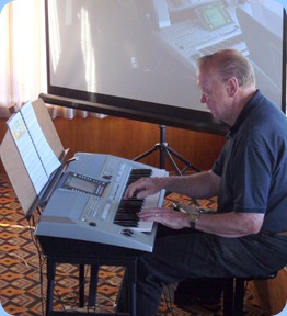 Colin Crann plaing his new Yamaha PSR-710 keyboard for the arrival music